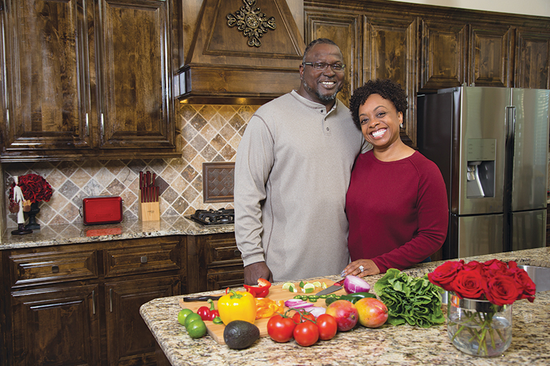 Patient Elaine McCray and husband in kitchen after she finds healing from GERD