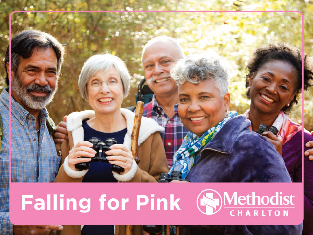 Two men and three women stand in a group in the woods. One woman holds binoculars and a hiking stick. Text reads: Falling for Pink Methodist Charlton.