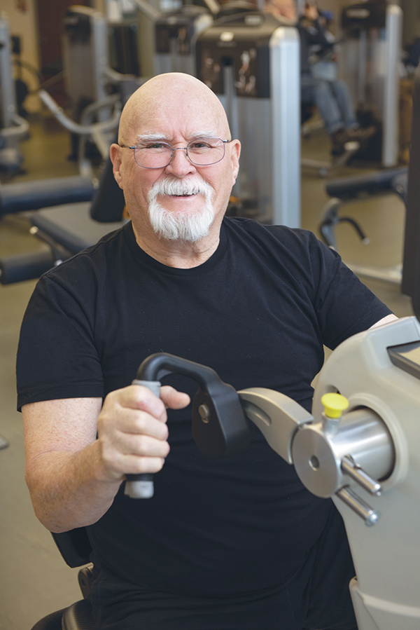Man with diabetes exercises in a gym