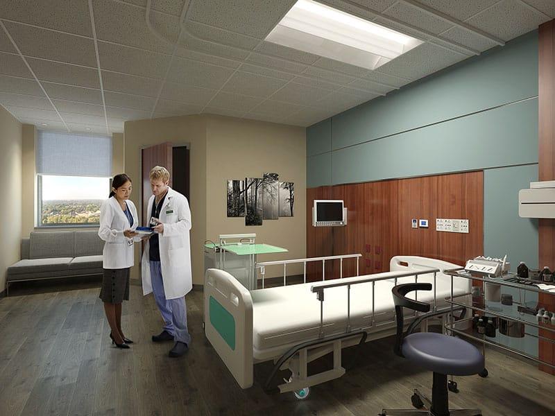 Doctors standing in patient room.
