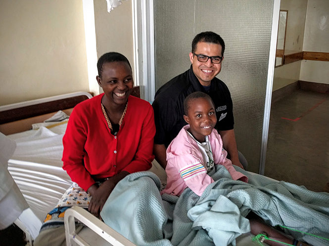 Dr. Edgar Araiza with woman and her son who broke his leg