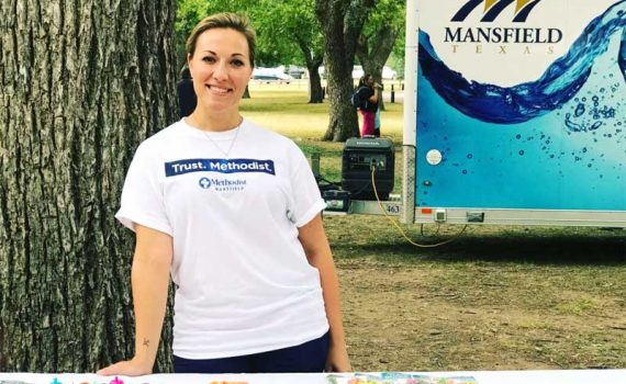 Anna Robbins represents Methodist Health System and raises drowning prevention awareness at Rose Park in Mansfield.