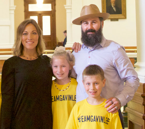 Anna Robbins with her husband, daughter, and son at the Texas State Legislature for Drowning Prevention and Awareness Week 2019.