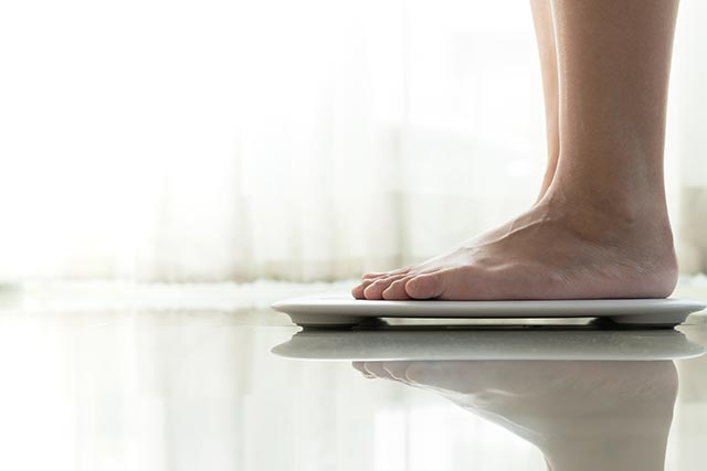 Feet standing on scale; weight loss support events