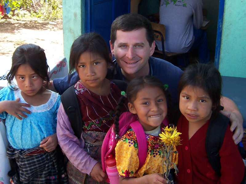 Dr. Shima with his young patients on a medical mission trip.