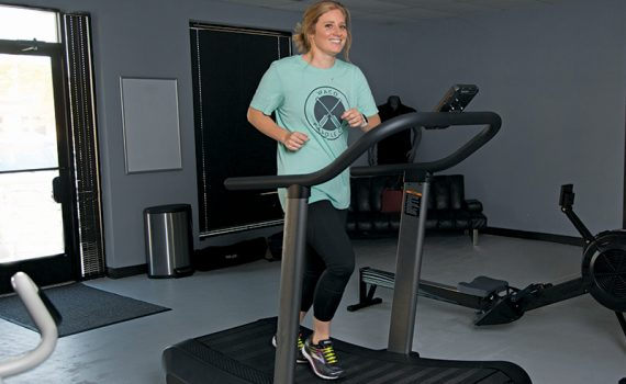 Runner Bailey Adams works out on treadmill after life-saving heart treatment