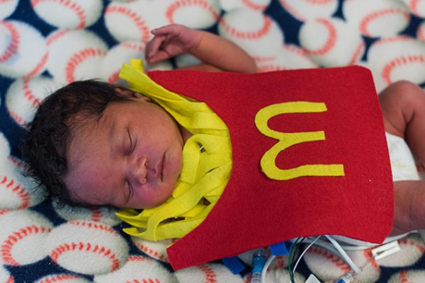 Baby in the NICU wears a crochet McDonald's french fry costume.