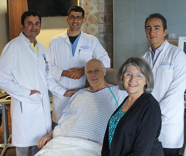 Liver transplant patient Mike Matthews and his wife, Patty, with his team at Methodist Dallas.