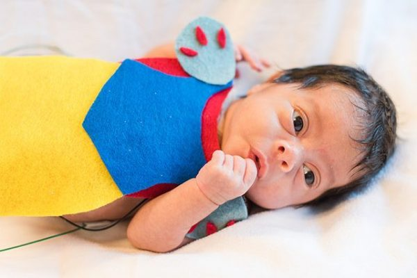Baby in the NICU wears a crochet Snow White costume.