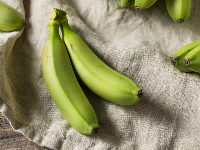 Green bananas as a healthy option for snacking in the car.