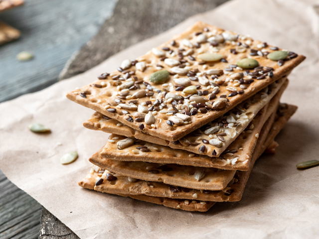 Stack of crackers with seeds as healthy option for snacking in the car.