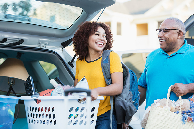 College student with father packing for start of school.