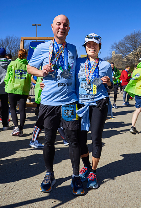 Liver transplant patient Mike Barker and his wife, Fatima, finish a race.