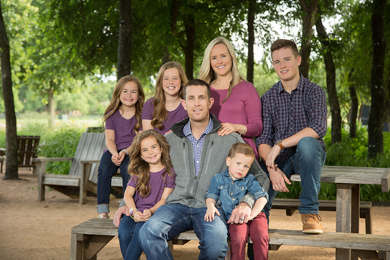 Kacey Hester and his wife Darla and their five children after he recovered from testicular cancer at Methodist Dallas.