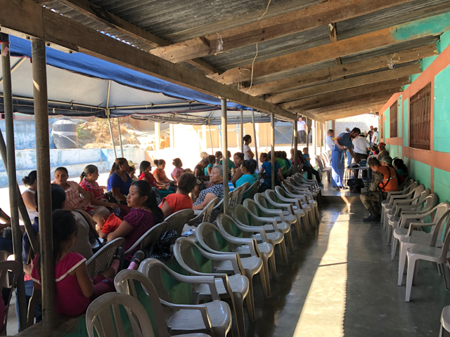 Dozens of patients line up to be seen at a medical clinic in a rural Guatemalan village during a Methodist medical mission trip.
