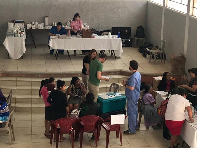 A makeshift medical clinic in the community center of a rural Guatemalan village during a Methodist medical mission trip.