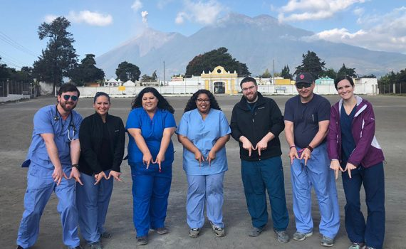 Medical residents in Guatemala make their hands in the shape of an M to support Methodist Health System in Dallas.