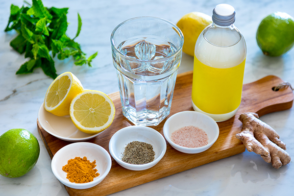 Water, lemon, ginger, and spices line up for ginger recipes.