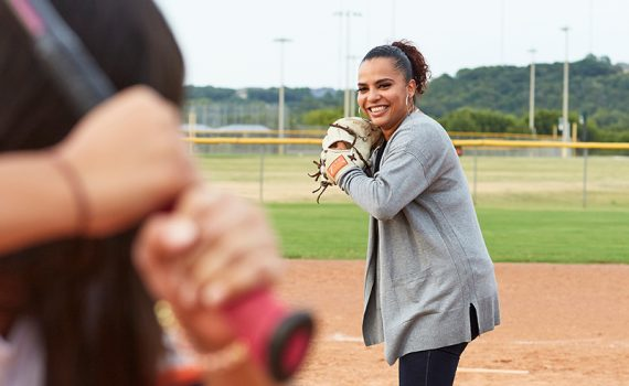Patient Jennifer Diosdado throwing baseball after being treated for a rare spine condition.