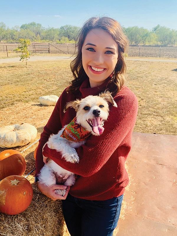 Awake brain surgery patient Jenna Schardt with her dog.