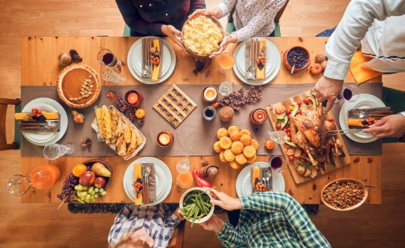 A holiday table with food and family. Cater to all food preferences and allergies with these recipe substitutions.