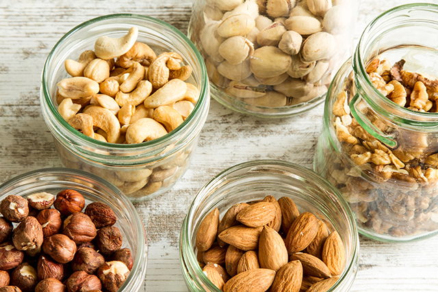 Jars of various nuts, which are a common allergy and can be substituted in many recipes.