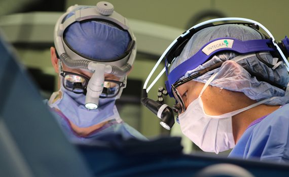 Surgeons operate during an awake brain surgery at Methodist Dallas.