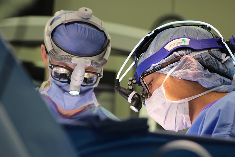 Surgeons operate during an awake brain surgery at Methodist Dallas.