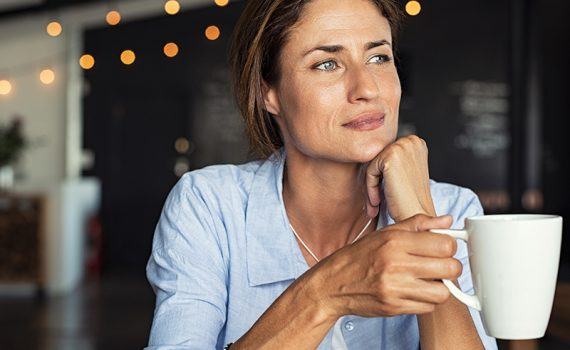 Woman sitting and looking off camera; read if hysterectomy is right for you.