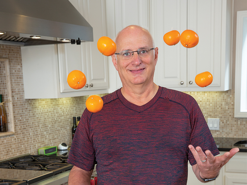 Tracy Edwards juggles oranges after his weight-loss surgery.