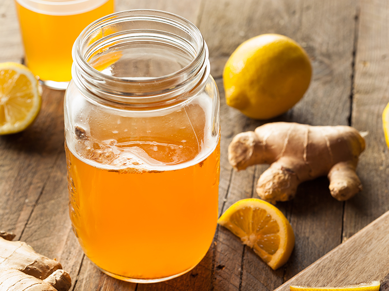 Glass of Kombucha with ginger and lemons; fermented foods may support gut health.
