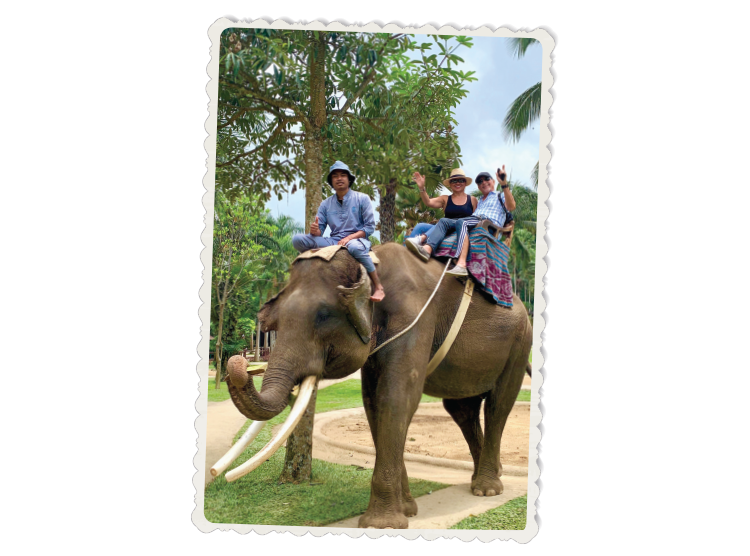 The Barulich's ride an elephant while on vacation