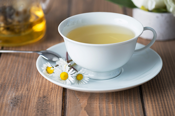 cup of camomile tea; health benefits of floral tea