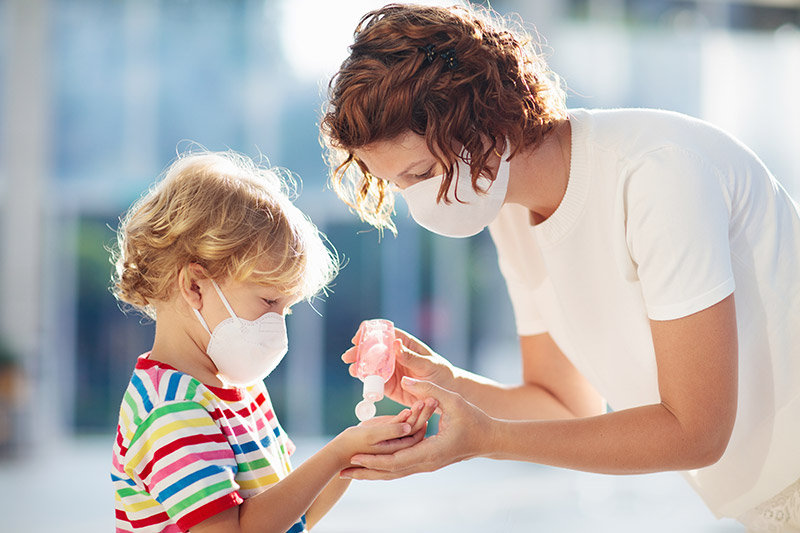 Mother and child wearing face masks to prevent COVID-19; mothers' stress compounded with COVID-19