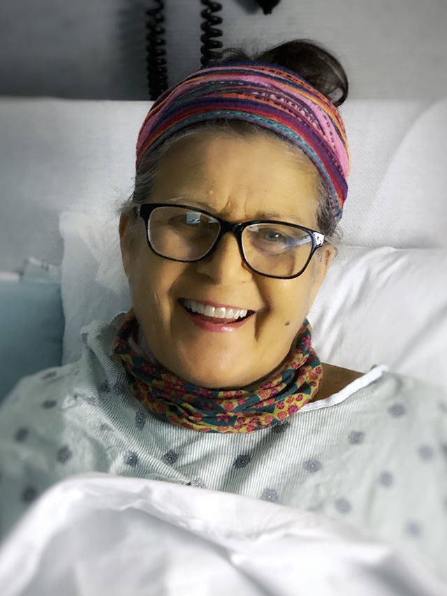 barbara winn smiling at camera in the hospital after transplant