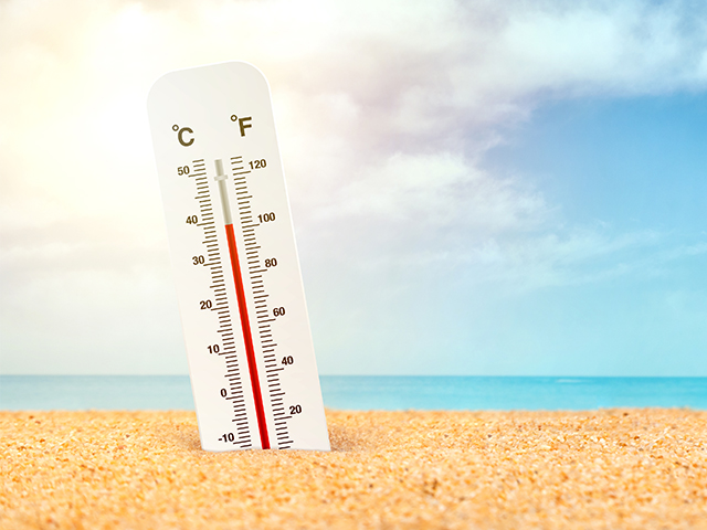 graphic of thermometer reading over 100 degrees fahrenheit sticking out of beach sand with ocean in background