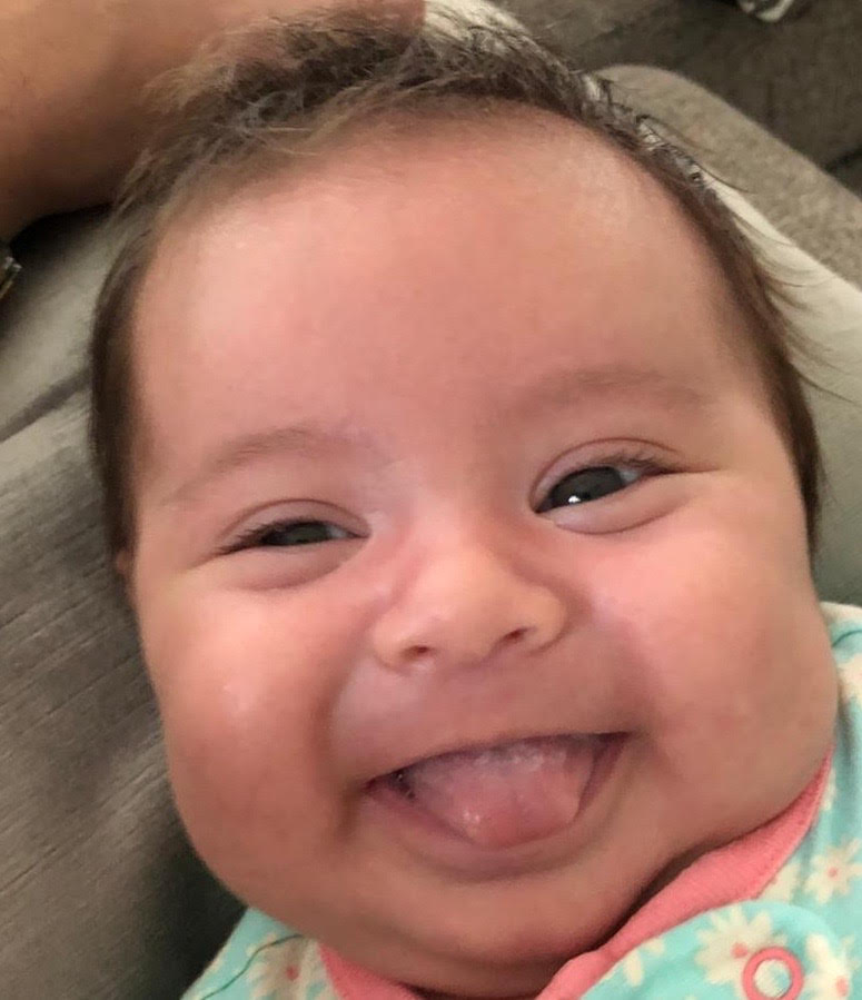 Adoptive parents Ana Tavares and Bruno Ribeiro's new daughter, Daphne, after parents were diagnosed with COVID-19