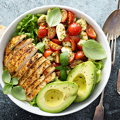 photo of a healthy chicken, tomato and avocado salad