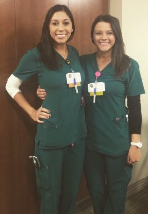 Best friends and nurses fighting COVID-19, Katie Cacioppo and Jessica Pena, side by side in their scrubs.