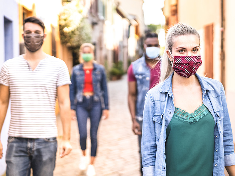 group of young people wearing masks