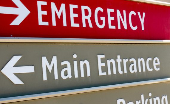 Hospital sign outside emergency rooms with red emergency