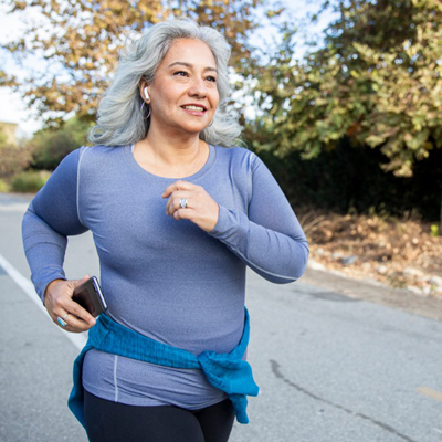Woman on a jog, promoting self-care during the pandemic