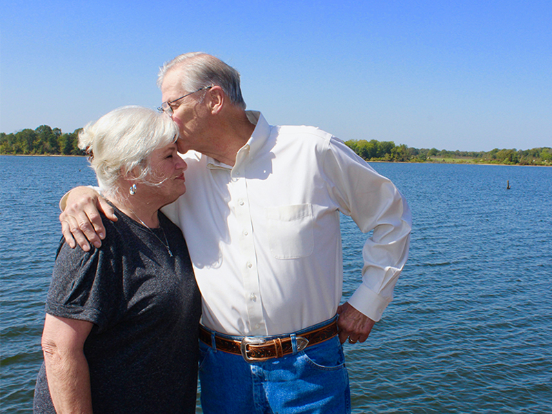 Kathy and Chuck Magers embracing and celebrating Chuck's recovery from pancreatitis