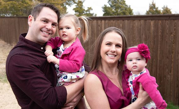 Colton and Samantha Crist with their two daughters after Samantha's newborn was born during a spike in COVID-19 cases.