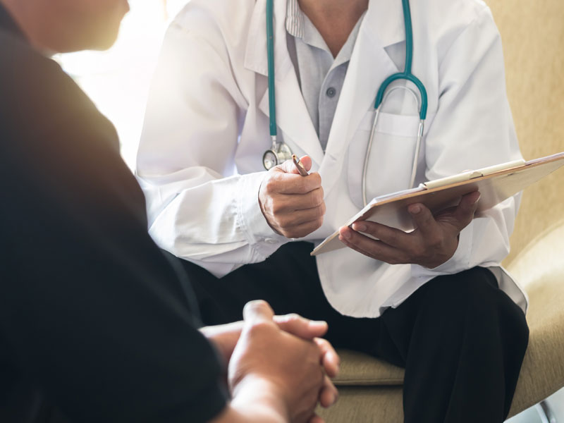 Doctor speaking with a patient, used to explain low-T treatments