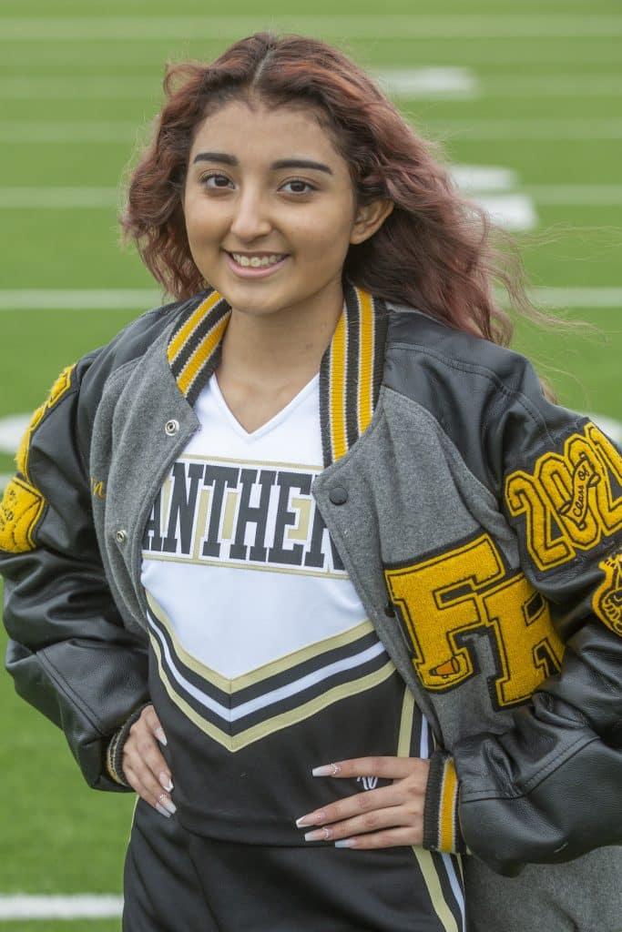 Cheerleader Nadia Gomez in her cheerleading uniform after her liver transplant