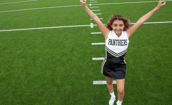 Nadia Gomez photographed cheerleading in her uniform after her liver transplant