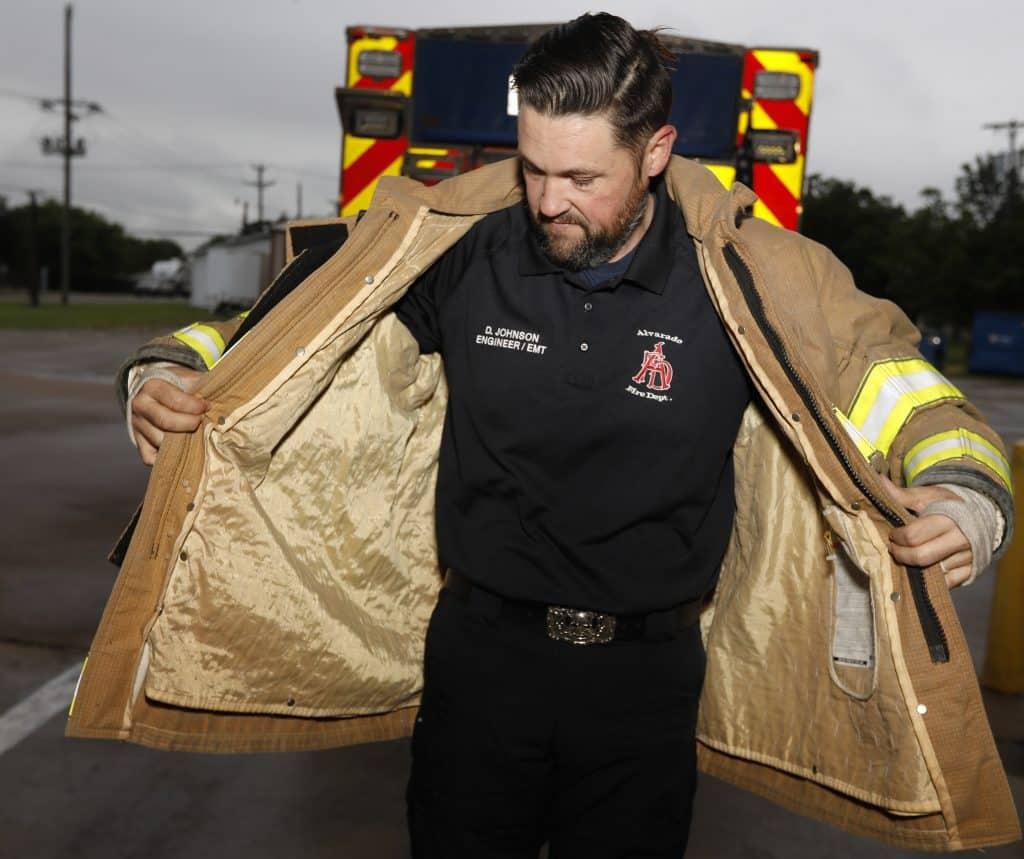 "Alvarado fireman Doug Johnson showing off his ""fat jacket"" from before bariatric surgery"