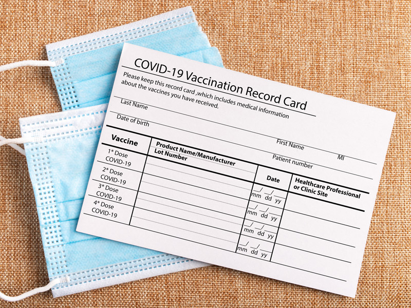 COVID-19 vaccine card with a mask