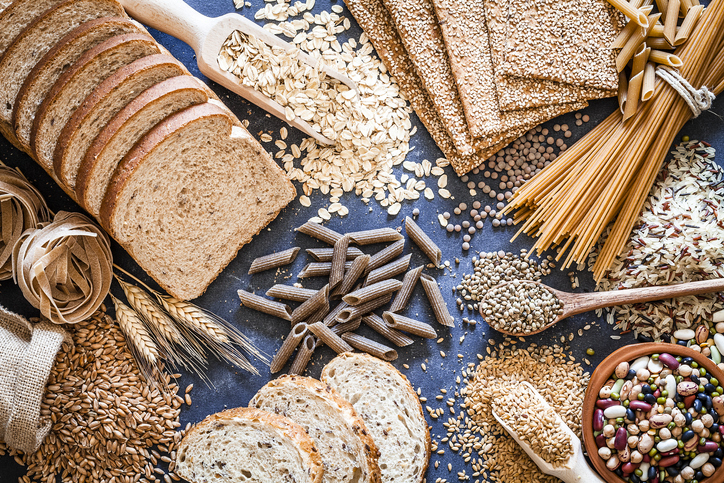 An array of whole grains, breads, legumes and pastas